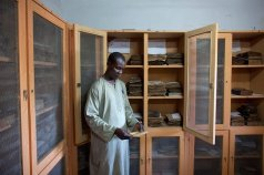 Librarian Aboubakar Yaro examines an Islamic manuscript from the 17th century at the Djenne Library of Manuscipts, in Djenne, Mali, September 2012. Djenne is thought to have at least 10,000 manuscripts held in private collections, dating from the 14th to 20th centuries. (REUTERS/Joe Penney (MALI - Tags: RELIGION SOCIETY) --- Image by © JOE PENNEY/Reuters/Corbis) Via Smithsonianmag.com