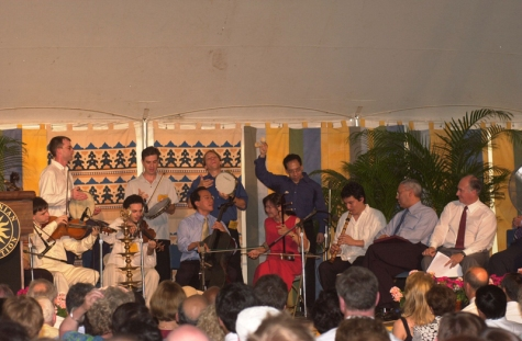 From the Ismailimail archives 2002-06-26: Yo-Yo Ma and members of the Silk Road Ensemble performing at the opening ceremony of the Smithsonian Folklife Festival. Secretary of State Colin Powell and His Highness the Aga Khan are seated at right. - Photo: AKDN/Zahur Ramji