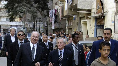 His Higness the Aga Khan on a walking site visit at Darb al Ahmer, Cairo accompanied by Luis Monreal, Director General of the Aga Khan Trust for Culture and Egyptian Government Officials.