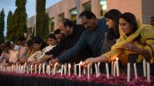 Pakistani legislators light candles during a vigil on May 14, 2015, for the victims following an attack by gunmen on a Shiite Ismaili minority bus in Karachi . (Image credit: ASIF HASSAN/AFP/Getty Images via The Globe and Mail)