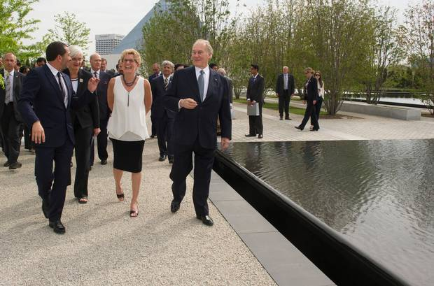 Landscape architect Vladimir Djurovic leads Ontario Premier Kathleen Wynne and His Highness the Aga Khan on a tour of the Aga Khan Park during its inauguration. The park encompasses the Aga Khan Museum and the Ismaili Centre, both of which were inaugurated last September. (Kevin Van Paassen for The Globe and Mail)