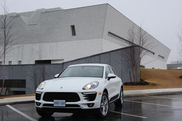 The 2015 Porsche Macan S in front of Aga Khan Museum in Toronto. Two illustrations of streamlined, sleek design. (Photo: KATHY RENWALD via Inside Toronto)