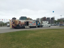 """The """"Together-Ensemble"""" Exhibition Bus at the Le Breton neighbourhood at the Canadian War Museum grounds. Photo: Malik Merchant/Simerg."""