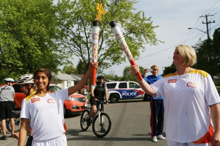 Maheen Awadia participates in 2015 Pan Am Games Torch Relay in Toronto