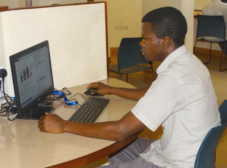 Student at the Aga Khan Academy, Mombasa undertaking his assignments using one of the computers at the school library. (Image via Coastweek)