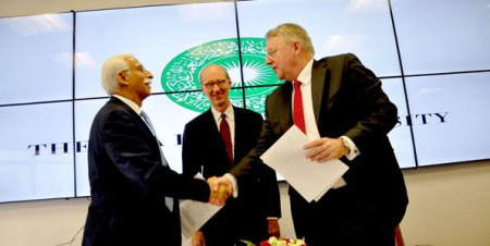 Aga Khan University, DW sign training pact