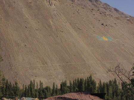 Khorog, Tajikistan: Ismaili flag on the mountain slope