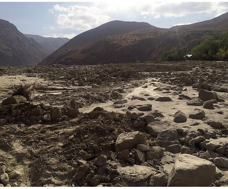 A flash flood carrying tons of mud and debris tore down this valley, washing away the homes and belongings of around 80 families in the Tajik village of Barsem. Abnormal weather patterns, possibly due to climate change, and the dangerous consequences are highlighting how many rural communities are ill-equipped to deal with the climate chaos. (Photo: EurasiaNet)
