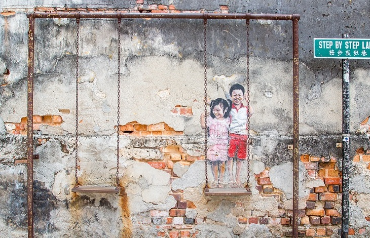 Realistic Children on the Swing at Step by Step Lane in George Town Malaysia. The Aga Khan Trust is once again working with the state government and Think City Sdn Bhd to provide technical assistance in restoration and preservation of the heritage site. (Image via The Rakyat Post)