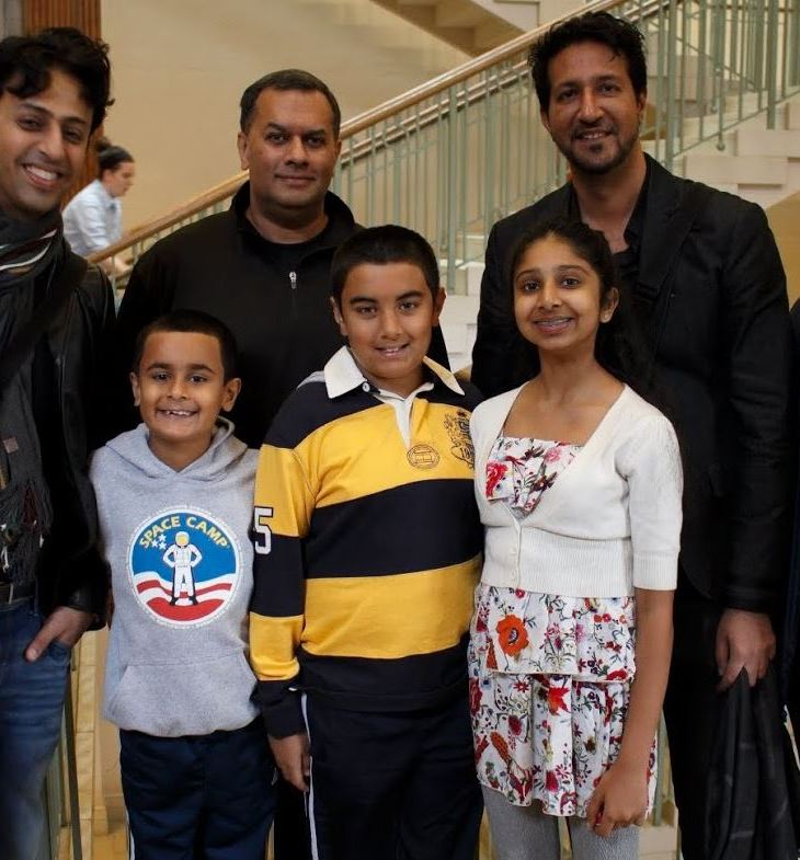 Back, Left to Right: Salim Merchant, Azeem Maherali, Sulaiman Merchant, and Professor Ali Asani. Front, Left to Right: Excited young fans: brothers Riyaan and Qayl Maherali; and Alyna Nanji. (Image credit: Anvar Nanji Copyright)