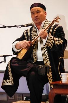 Kazakh musician Almasbek Almatov plays the dombra. (Photograph: Linda Vartoogian/Getty Images via The Guardian)
