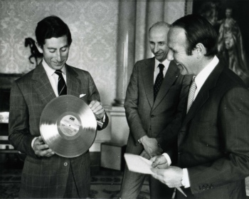 "Prince Charles was given the record ""Golden Soul"" by the UN High Commissioner for Refugees Sadruddin Aga Khan (right) during a ceremony. (Image credit: UNHCR Photos/ 1977)"
