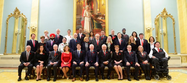 The swearing-in ceremony of the new Prime Minister, the Right Honourable Justin Trudeau, seated 5th from left, and his cabinet took place at Rideau Hall on Wednesday November 4, 2015. The ceremony was presided by the Governor General of Canada, the Right Honourable David Johnston, who is is shown in the photo on the right of the Prime Minister. (Image credit: Sgt. Ronald Duchesne, Rideau Hall)