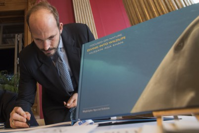 Monaco, November 7-9, 2015: Prince Hussain Aga Khan signing his book, Diving into the Wildlife at the BLUE Ocean Film Festival & Conservation Summit. (Image credit: Monaco Reporter)