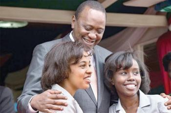 The Aga Khan Academy, Mombasa students Magdalena Gakuo and Sumera Yego with his Excellency President Uhuru Kenyatta, during the award ceremony. (Image via Coastweek)