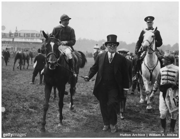 1930: His Highness the Aga Khan III leads in Blenheim after winning the Derby race (w H Wragg) at Epsom. (Photo by P William A. Atkins/Central Press/Getty Images)