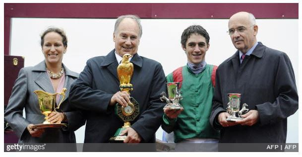 October 5, 2008: His Highness Prince Karim Aga Khan IV, his daughter Princess Zahra, Belgian jockey Christophe Soumillon (2dR) and trainer Alain de Royer Dupre (R) – all pose with trophies after winning the 87th Prix de l'Arc de Triomphe race riding favorite filly Zarkava on at Longchamp racetrack in Paris. Zarkava produced one of the greatest performances in racing history here at Longchamp as she became the first winner to come from stall one since Prince Royale II in 1964 to win the Prix de l'Arc de Triomphe. (Photo by Stephane de Saukutin AFP Photos/Getty Images)