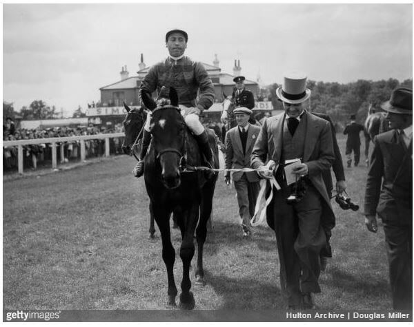 28th May 1952: Prince Aly Khan, son of His Highness the Aga Khan III, leads in his horse, Tulyar after it had won the Derby at Epsom. (Photo by Douglas MillerFox Photos/Getty Images)