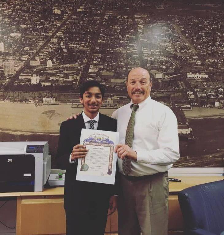 Mayor Tony Vazquez, City of Santa Monica, presents Certificate of Commendation to Danial Asaria