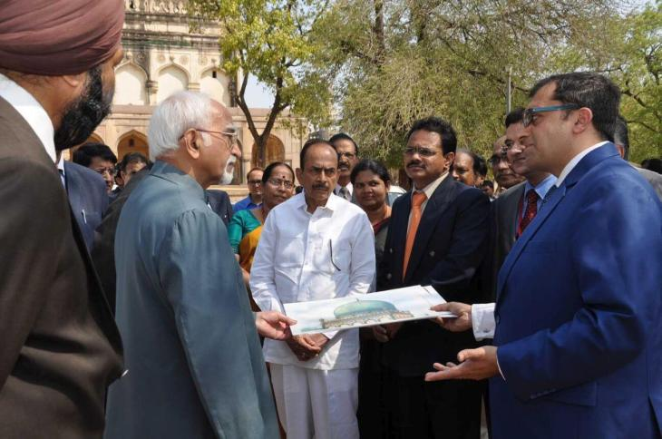 Mr. Ratish Nanda, CEO, AKTC appraising explains architecture and significance of the area to the Vice President of India Mr. Hamid Ansari along with Governor Sri E.S.L. Narasimhan and other senior government officials on their visit to Qutb Shahi Tombs (Image via Siasat Daily)