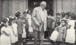 Ismaili children greet Imam Sultan Mahomed Shah during his visit to Ismaili Centre at Palace Gate, London, UK, on July 19, 1953 (Photo: Ilm, Centenary Issue)