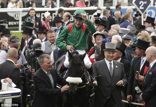 Aga Khan leads his team. Pat Smullen celebrates after riding Harzand to victory in the 4.30 Investec Derby Action Images via Reuters Henry Browne Livepic