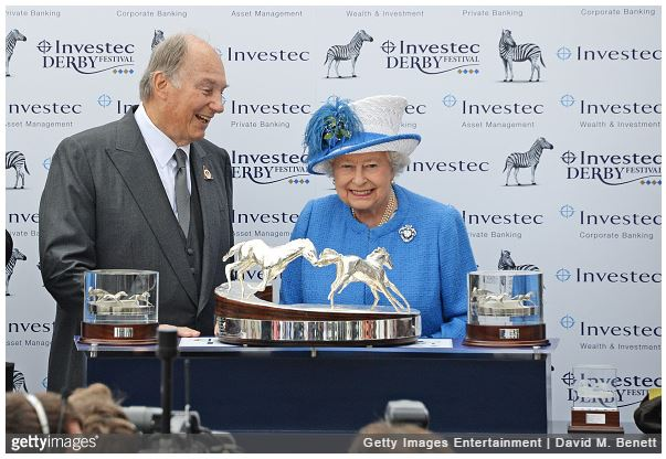 His Highness The Aga Khan receives the Investec Derby trophy for his winning horse Harzand from HRH Queen Elizbaeth II during Derby Day at the Investec Derby Festival, celebrating The Queen's 90th Birthday, at Epsom Downs Racecourse on June 4, 2016 in London, England.