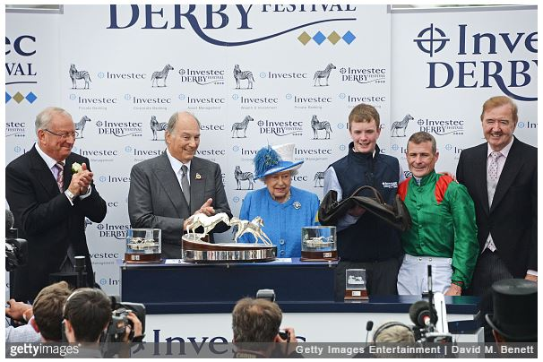 LONDON, ENGLAND - JUNE 04: (L to R) Global Managing Director of Investec Bernard Kantor, His Highness The Aga Khan, Queen Elizabeth II, groomer Patrick Murray, jockey Pat Smullen and horse trainer Dermot Weld pose in the winners enclosure after horse 'Harzand' won the Investec Derby during Derby Day at the Investec Derby Festival, celebrating The Queen's 90th Birthday, at Epsom Downs Racecourse on June 4, 2016 in London, England. (Photo by David M. Benett/Dave Benett/Getty Images for Investec)