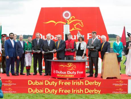Harzand connections receives the Dubai Duty Free Irish Derby from Colm McLoughlin during the presentation ceremony.