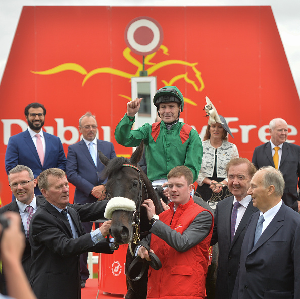 Kildare , Ireland - 25 June 2016; Pat Smullen celebrates on Harzand alongside trainer Dermot Weld, second from right, in the winner's enclosure after the Dubai Duty Free Irish Derby at the Curragh Racecourse in the Curragh, Co. Kildare. (Photo By Cody Glenn/Sportsfile via Getty Images)