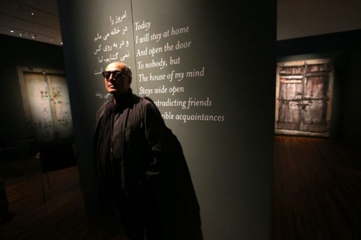 "Abbas Kiarostami in his installation ""Doors Without Keys"" at the Aga Khan Museum. Kiarostami, a quiet master of international cinema. (Image credit: Vince Talotta via Toronto Star)"