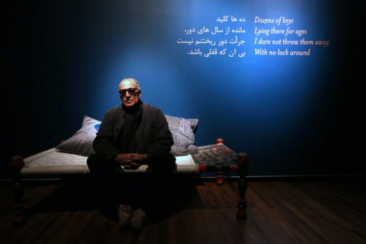 """Abbas Kiarostami in his installation """"Doors Without Keys"""" at the Aga Khan Museum. Kiarostami prefers to live and work in Iran, saying censorship shapes the work but doesn't destroy it. (Image credit: Vince Talotta via Toronto Star)"""