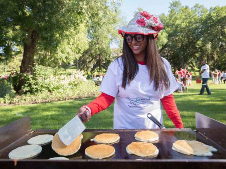 Serena Hemraj flips pancakes for the pancake breakfast, hosted by the Aga Khan Council of Edmonton, during Canada Day festivities at the Alberta Legislature in Edmonton July 1, 2016. (Image credit: AMBER BRACKEN/EDMONTON JOURNAL)