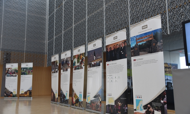 Thirty banners describing the work of the AKDN in countries around the world were arranged in the atrium of the Delegation building for the Imamat Day reception. (Image credit: AKDN / Safiq Devji)