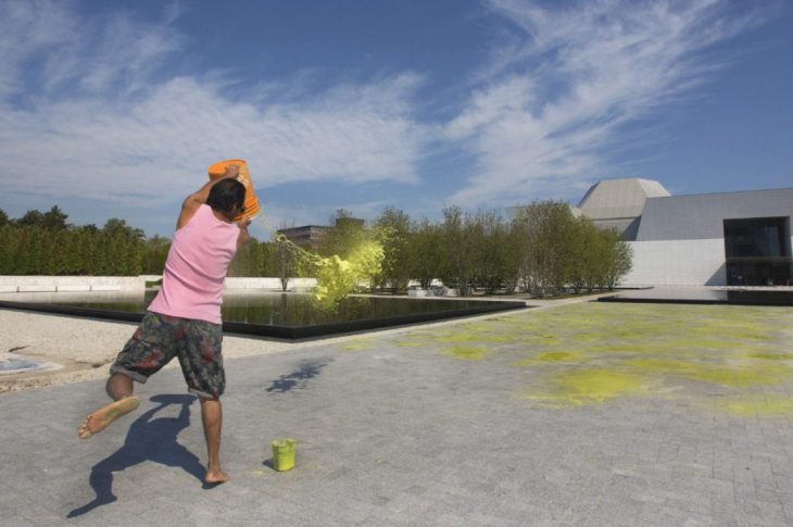 Imran Qureshi splatters paint on a huge expanse of concrete brick outside the Aga Khan Museum (Image credit: Toronto Star)