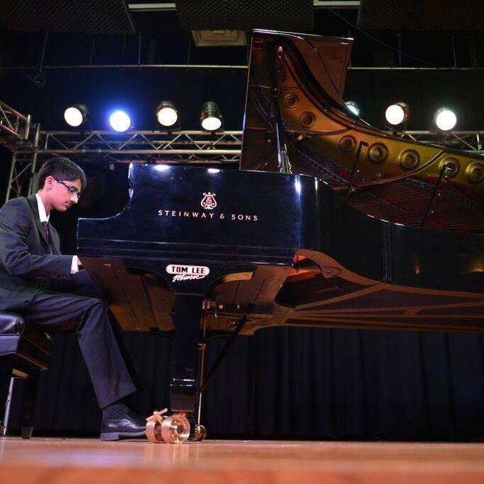 Student Aman Jina performs on piano at Ehrbar Hall, Vienna, and Carnegie Hall, NY