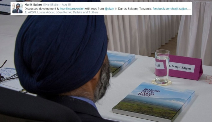 "Canada's Minister of National Defence, Harjit Sajjan, learning about Canada's partnership with AKDN and AKDN's experience in the East African region. AKDN Project brief ""Where Hope takes Root,"" on the table. (Image credit: Harjit Sajjan's Twitter page)"