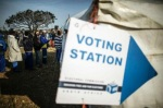 South African voters queue outside a polling station on August 3, 2016 during the municipal elections.