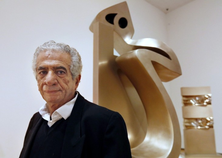 "Iranian artist Parviz Tanavoli stands near one of his sculptures called ""Heech on Chair"" at the Davis Museum on the campus of Wellesley College. AP Photo/Steven Senne"