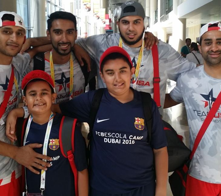 Riyaan (front left) is seen pictured with his older brother Qayl after Team USA Blue players (l to r) Adnan Dahlvani, Zohib Hadi, Naushad Lalani and Irfan Charania autographed his cap. (Image Credit ASJM)