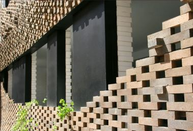 Facade entirely covered with a mesh of bricks, 40 Knots House, Tehran, Iran