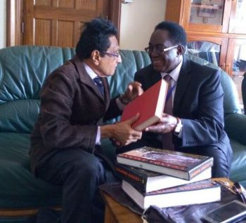 VIVJ with the Makerere Vice Chancellor. Red is his PhD dissertation, Stanford1976
