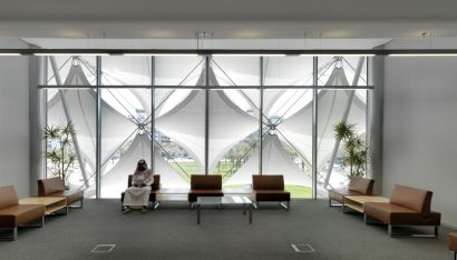 White membranes gently distribute the indirect daylight throughout the entire interior. AKAA / Cemal Emden