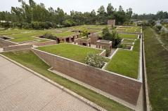 The green cover of the earthen rooftops. Aga Khan Award for Architecture 2016 Winner: Friendship Centre Gaibandha, Bangladesh