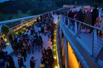 View at dusk. Aga Khan Award for Architecture 2016 Winner: Tabiat Pedestrian Bridge, Tehran