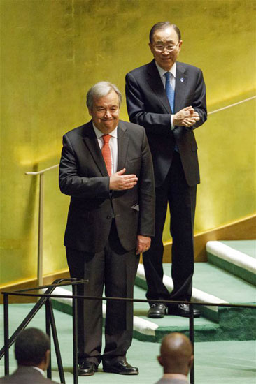 Antonio Guterres (front) gestures after he was appointed as the new UN Secretary-General at the UN headquarters in New York, Oct. 13, 2016. (Image credit: Seth Wenig/Associated Press)