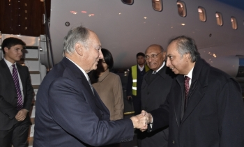 Dr Mahmoud Eboo, Chairman of the Ismaili Leaders' International Forum, welcomes Hazar Imam at the Bishkek Airport. GARY OTTE/TheIsmaili