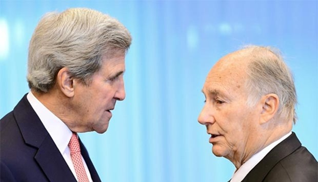 US State Secretary John Kerry speaks with His Highness the Aga Khan (Prince Shah Karim Al Husseini Aga Khan IV) as they attend the Brussels Conference on Afghanistan (image via Gulf Times)