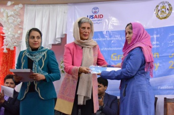 English Upper-Intermediate Graduate Nasima Puya Habibi (right) receives certificate from Mrs Nurjehan Mawani (left), Aga Khan Development Network Diplomatic Representative.