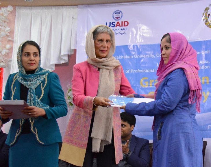 English Upper-Intermediate Graduate Nasima Puya Habibi (right) receives certificate from Mrs Nurjehan Mawani (left), Aga Khan Development Network Diplomatic Representative.